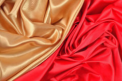 Background from golden and  red satin fabric Stock Photo