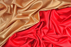 Background from golden and  red satin fabric Royalty Free Stock Image