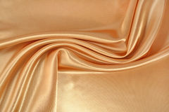 Background from golden satin fabric Stock Image