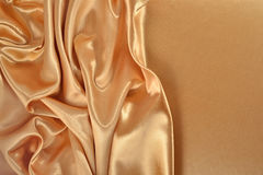 Background from golden satin fabric Royalty Free Stock Photos