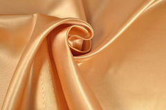 Background from golden satin fabric Stock Photo