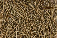 Background of golden screws. View from above. Stock Photography