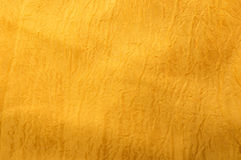 Background of a golden silk Stock Images
