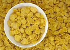 Background of goldish corn flakes with dish royalty free stock photo
