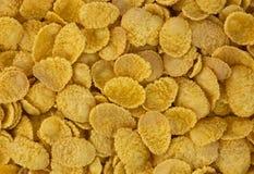 Background of goldish corn flakes royalty free stock image