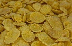 Background of goldish corn flakes stock image