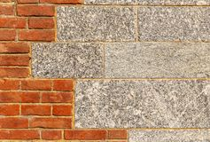 Granite and red brick wall. Background of granite and red brick wall combination Royalty Free Stock Photography