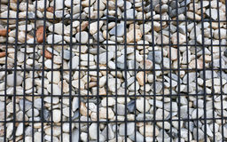 Background, Granite retaining wall reinforced with steel grid Royalty Free Stock Image