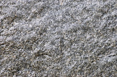 Background of a granite stone. Structure and texture of a granite stone Royalty Free Stock Photography