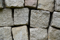 Background from the granite stone blocks added in a stack.  royalty free stock photos