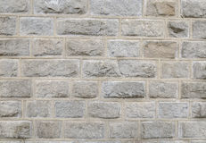 Background of a granite stone wall. Background of a stone granite wall to put notes or fondes of web Stock Photos