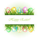 Background with grass and Easter eggs Stock Photography