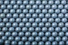 Background of gray airsoft balls of 6mm.  Stock Photo