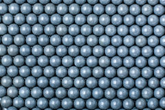 Background of gray airsoft balls of 6mm.  Royalty Free Stock Photos