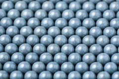 Background of gray airsoft balls of 6mm.  Stock Images