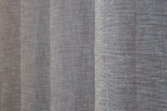 Background gray beige linen curtain close up stock image