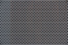 Background of gray metal with holes Stock Image