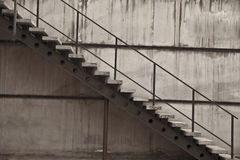 Background of gray stairway on the side of a building. Fire Stairway on side of building with a tiled wall Stock Photography