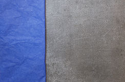 Background from gray stone with blue paper Royalty Free Stock Photos