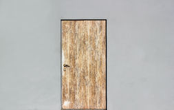 Background of a gray wall with closed wooden door Royalty Free Stock Image