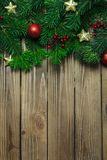 Old grunge wooden board with Christmas border stock images