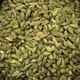 A background of green cardamom pods Royalty Free Stock Photography