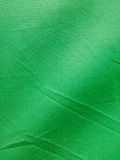 Background of green cloth covering the surface. Royalty Free Stock Photos