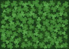 Background with green clovers. Of different color and size Royalty Free Stock Photography