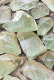 Background of green crystal raw broken in wal Royalty Free Stock Images