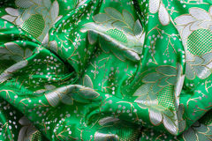 Background of green fabric with flowers. Gold flowers on green fabric. Background of green fabric with flowers Stock Photos