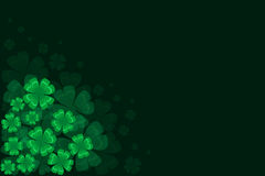 Background with green four-leaf clover St. Patrick. Black green background with four-leaf clover to St. Patrick holiday Stock Photos