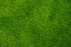Background green grass top view. Artificial grass or lawn royalty free stock image