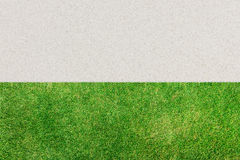 Background of green grass and white sand. Royalty Free Stock Photo