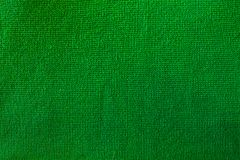 Background of green knitted fabric stock photo
