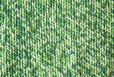 Background from green knitted wool Stock Photos