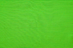 Background with green lines. Green splendid textile background with horizontal stripes Royalty Free Stock Image