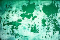 Background from green metal door with paint peeling off from old age royalty free stock image