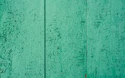 Background of green wooden surface stock image