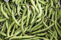 Green peas. Background of green peas at street market Stock Image