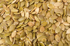 Background of green peeled pumpkin seeds Stock Photo