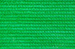 Background of green plastic mesh Royalty Free Stock Images