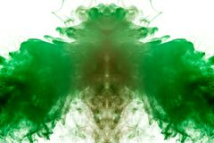 A background of green, red and gray wavy smoke in the shape of a ghost`s head or a man of mystical appearance on a white. Ground. Bright abstract pattern of stock photo