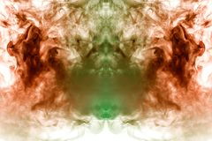 A background of green, red and gray wavy smoke in the shape of a ghost`s head or a man of mystical appearance on a white. Ground. Bright abstract pattern of stock image