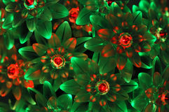 Background from green and red neon lights. Closeup on a garland of christmas green and red lights in a shape of flowers on black background Stock Photo