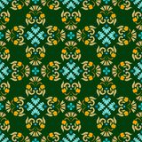 Background, green, seamless pattern with gold and blue flowers. Royalty Free Stock Images