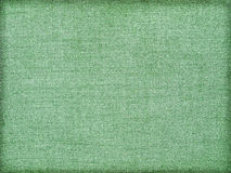Background of green tissue. Background of green fabric with a textured yarns Stock Photography