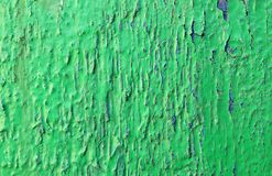 Texture old peeling paint green with blue crack royalty free stock photography