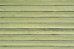 Background green wooden texture. Abstract green colored wooden texture of garage door. It is old and aged with signs of cracking and weathering from the wind royalty free stock photography