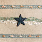 Background for greeting card. Background with a blue starfish, seashells, ribbons and beads Royalty Free Stock Images