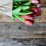 Background, greeting card: bouquet of multicolored tulips on a light background. Layout, mocap, for your text mother's day, copys. Floral, spring Background Stock Images